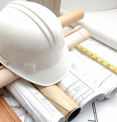 Hard hat on construction plans